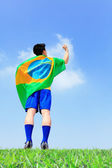 Excited man holding a brazil flag — Photo
