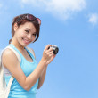 Happy woman traveler taking photo by camera — Stock Photo #44656865
