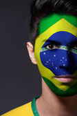 Man with a painted flag of Brazil — Stock Photo