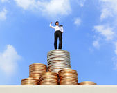 Successful business man standing on growth money stairs coin with sky — Stock Photo