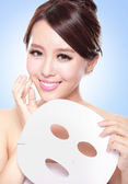 Happy Young woman with cloth facial mask — Stock Photo