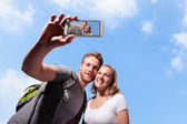 Happy couple selfie by smart phone — Stock Photo
