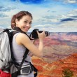 Woman mountain hiker taking pictures — Stock Photo