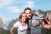 Happy couple selfie in yosemite — Stock Photo