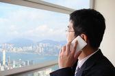 Business man talking on smart phone — Stock Photo