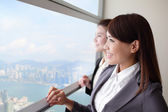 Business woman looking through window — Stock Photo