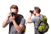 Tourist using camera with backpack — Stock Photo