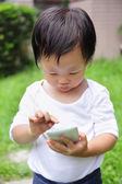 Child using smartphone — Stock Photo