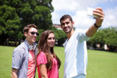 Group of happy friends taking selfie — Stock Photo