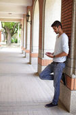 Happy Student man using touch pad — Stock Photo