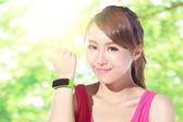 Sport woman wearing smart watch — Stock Photo