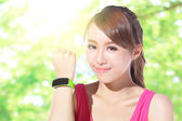 Sport woman wearing smart watch — Stock Photo