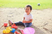Child play in sand — Stock Photo