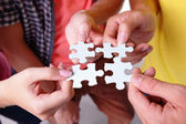 Young People take four puzzle — Stock Photo
