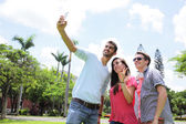 Happy friends taking selfie — Stock Photo