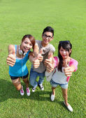 Happy students in campus — Stock Photo