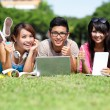Happy College students using computer — Stock Photo #51381615