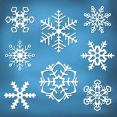 Silhouettes orné de flocon de neige — Vecteur