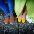 Stock Photo: Couples legs dressed in bright colorful shoes