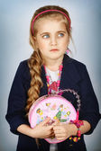 Portrait of caucasian little pretty girl looking to the left side — Stock Photo