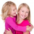 Sisters hugging and looking at each other — Stock Photo #12381867