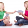 Sisters or friends playing cards — Stock Photo