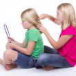 Sisters combing hair — Stock Photo
