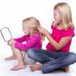 Sister doing younger sisters hair — Stock Photo