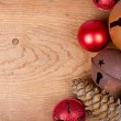 Christmas ornaments on wood panel — Stock Photo