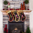 Christmas stockings hanging from a mantel or fireplace — Stockfoto