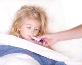 Sick childl with a thermometer in mouth — Stockfoto