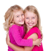 Sisters hugging — Stock Photo