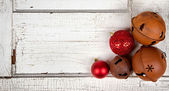 Christmas ornaments on wood panel — Stock Photo