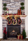 Christmas stockings hanging from a mantel or fireplace — 图库照片