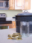Canning jars and supplies in a kitchen — Stock Photo