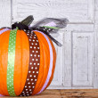 A pumpkin decorated with ribbon — Stock Photo