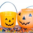 Halloween candy and pumpkin bucket on wood — Stock Photo #13891102