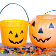 Halloween candy and pumpkin bucket on wood — Stock Photo