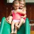 Two girls going down slide — Stock Photo #13891163