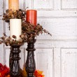 Autumn still life with candles and leaves — Stock Photo