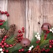 Royalty-Free Stock Photo: Christmas berries on wooden background