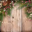 Christmas berries on wooden background - Stock Photo