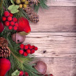 Christmas decorative fruit on wood - Stock Photo
