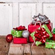Christmas Presents on Wooden Background — Stock Photo #13949879