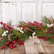Christmas berries on wooden background — Stock Photo