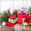Christmas Presents on Wooden Background - Stock Photo