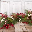 Stock Photo: Christmas berries on wooden background