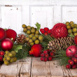 Christmas fruit on a wooden background - Stock Photo