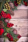 Christmas decorative fruit on wood — Stock Photo