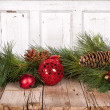 Stock Photo: Christmas ornaments on wooden background
